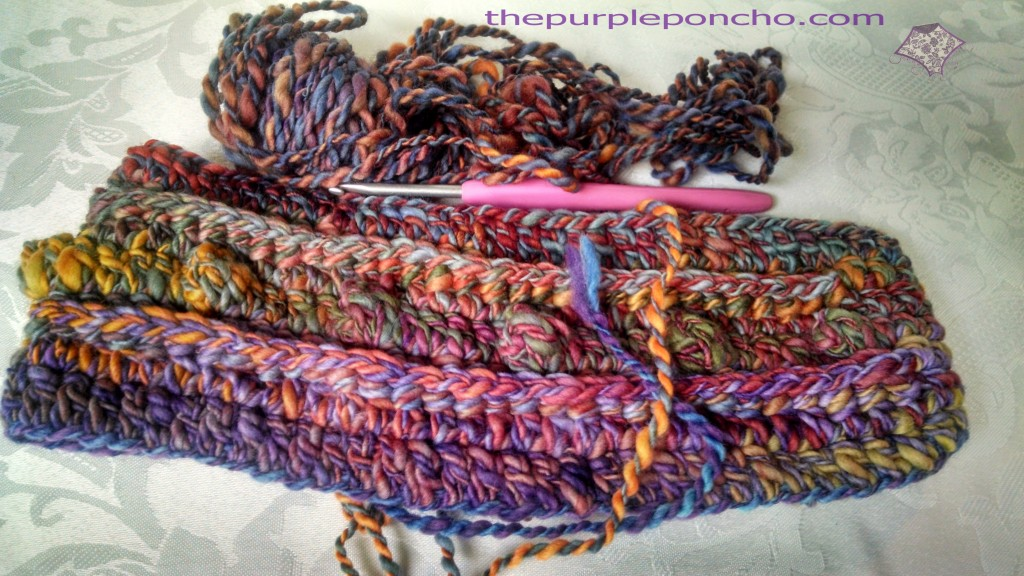Love this yarn - headband needs a border.