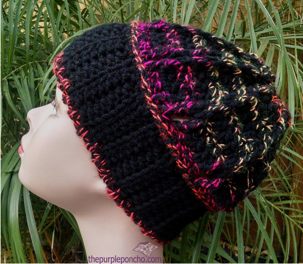 Climbing Braids Beanie in Hobby Lobby in the color Firecracker and Red Heart with Love in black.
